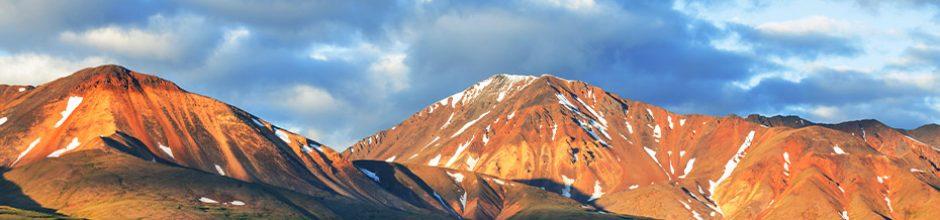 Mountain range lit by summer afternoon sun
